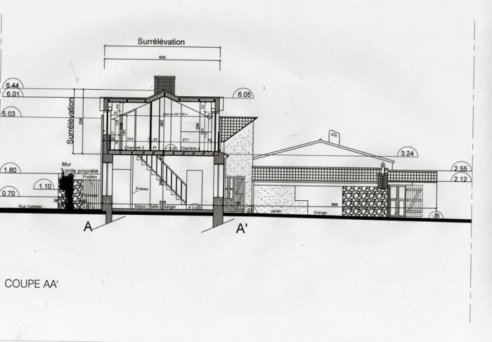 Surélévation d'une maison et construction d'un garage : Coupe
