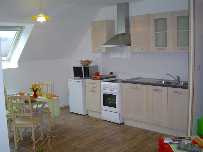 Transformation d'une partie du vélo en logements saisonniers : Cuisine salon